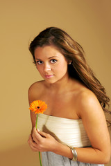 Beautiful and Elegant young lady holding a flower