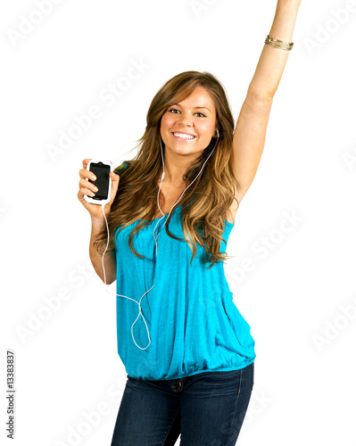 Portrait of a beautiful brunette teen dancing to music