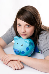 young girl smiling with piggy bank