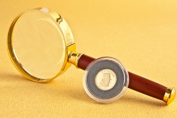 Coin and magnifier
