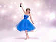 Beautiful woman in blue dress with champagne