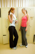 Two girls in locker room after training