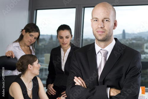 Fout businesspeole with a attractive boss in the front