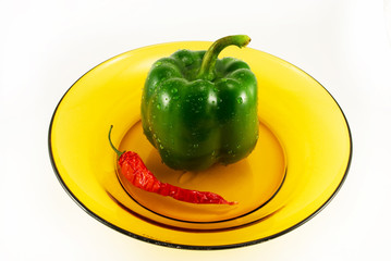 pepper and chile in a plate on a white background