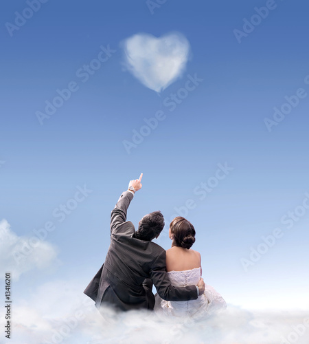 Heart of cloud - studio shot of a wedding couple