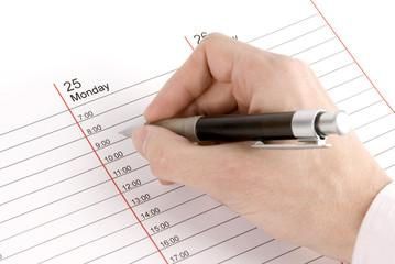 Hand writing a memo