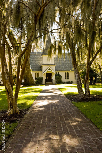 Small Church Down Brick Path Past Spanish Moss