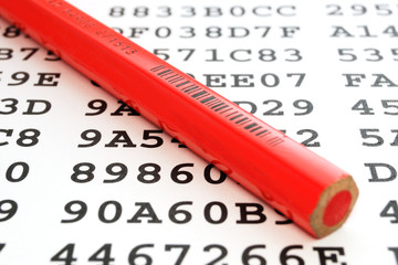 A red pencil on a sheet with encrypted data