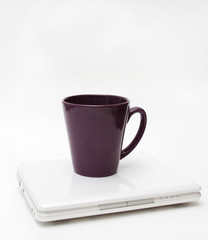 White Laptop and Purple Cup