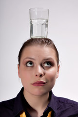 Girl with a Glass of water on head, Isolated