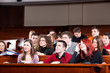 Group of students listening lecture in classroom