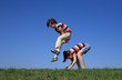 Kids jumping, running against blue sky