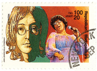 vintage stamp with John Lennon and Ella Fitzgerald