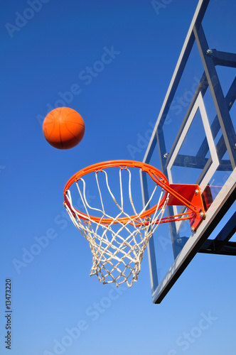 Basketball Shot Heading Toward the Hoop, Blue Sky