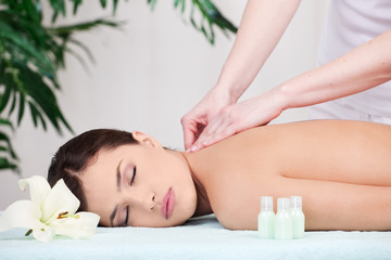 Woman on back massage in spa center