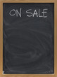 sale advertisement on blackboard in vertical