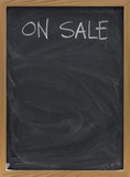 sale advertisement on blackboard in vertical poster