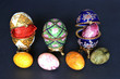 Casket porcelain eggs with decorative eggs over black