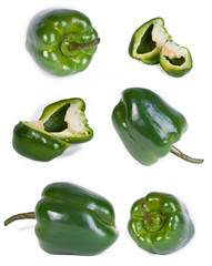 Assorted sweet bell green papricas on a white background