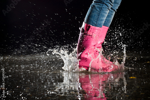 girl jumping in the puddle