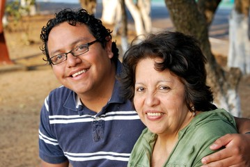 Hispanic mother and her grown son