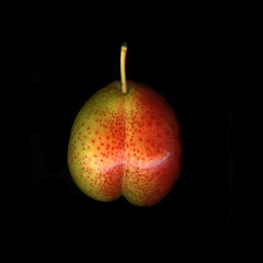 Single organic fresh pear isolated on black background