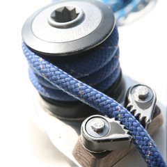 blue boater's rope on belaying cleat, yacht equipment