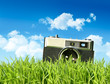 Vintage camera in tall grass