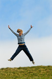 girl jumping for joy