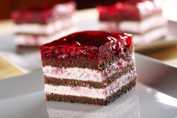 Biscuit cake with raspberry cream and jelly