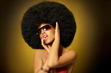Beautiful woman with huge afro haircut on yellow poster