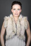 High Fashion Shot of a Stunning Brunette in Mock Fur Gillet poster