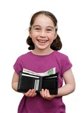 Smiling seven years girl with pigtails holds a wallet with money poster