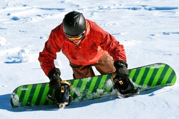 Snowboarder climbing snow slope
