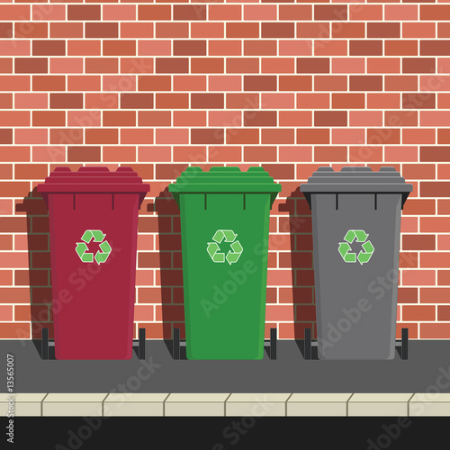 Recycling Bins Against Brick Wall