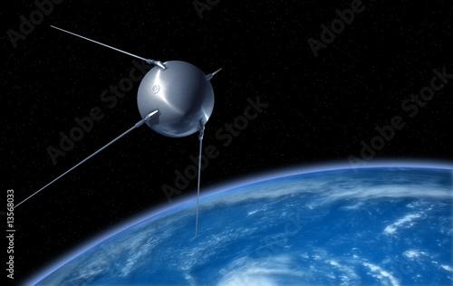Sputnik satellite on earth orbit - 13568033