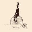roleta: Victorian sport: gentleman riding retro big wheel bycicle