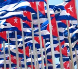 dozens of Cuban flags in the wind