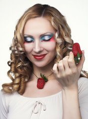 Portrait of young woman with  strawberry's