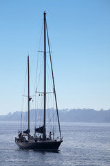 Sailing boat coming into harbour