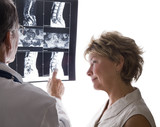 Doctor and Patient Reviewing MRI, Xray Scans poster