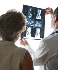 Doctor and Patient Reviewing Scans of Patient's Back