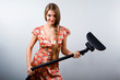 Funny housewife with vacuum cleaner