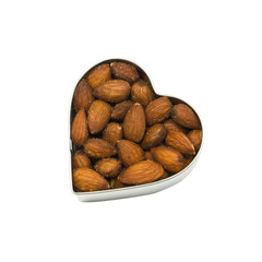 top down view of heart filled with almonds