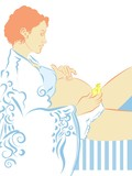 Pregnant woman massaging her abdomen