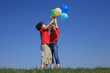 Kids holding balloons ,playing outdoor
