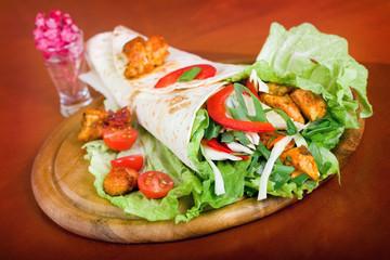 Closeup fresh tortilla on wooden tray