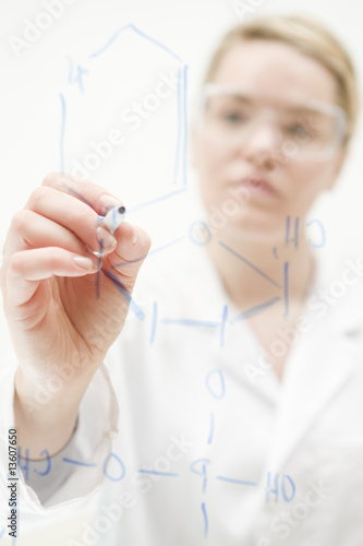 Woman Scientist Writing Molecular Structure