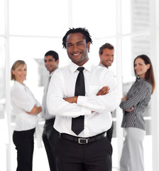 Portrait of a businessman standing in front of co-workers
