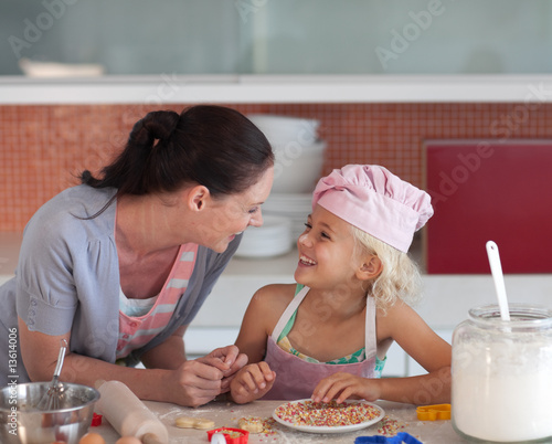 Potrait of mother and Daugther in Kitchen preparing food